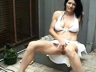 Sinewy MILF masturbates increased by squirts