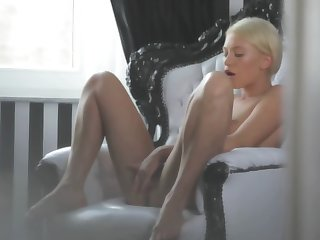 A hot blonde is tweaking her cunt lips with her frontier fingers really well