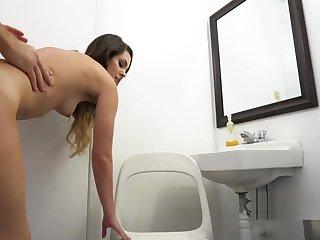 Cute brunette bangs in public restroom