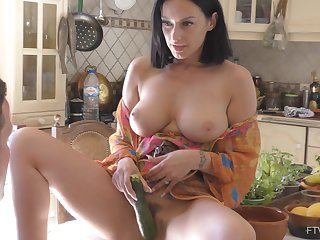 Unexpected masturbation in the kitchen with a cucumber makes Cassie cum
